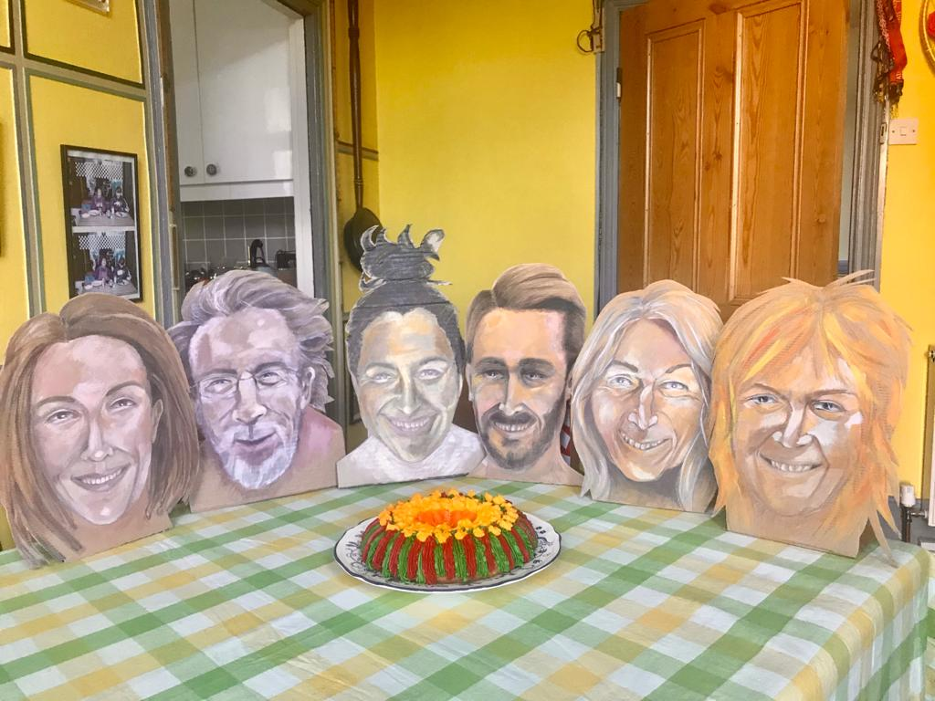 Cardboard cutouts of six people enjoying a dessert - due to lockdown, they can't be together
